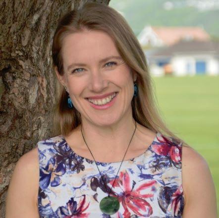 Sarah smiling in park