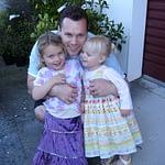 Father cuddling 2 girls